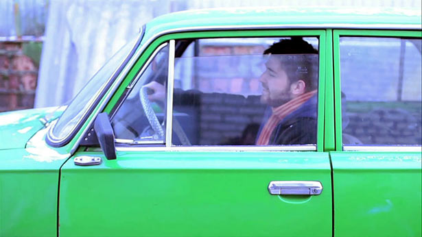 Cody White in a very hip green Russian car